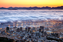 Low clouds over harbor by CG Mostert